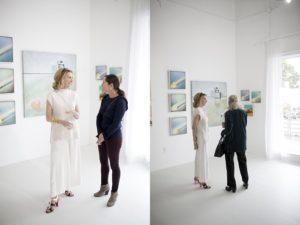 Art Buckhead artist talking to popup gallery event attendee at Park Studios Atlanta