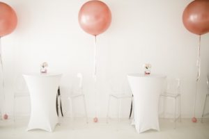 white tables with champagne oversized balloon