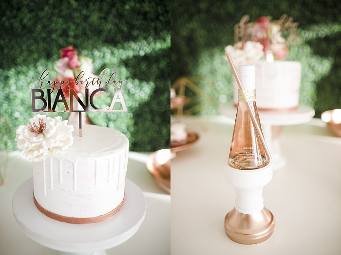 white 40th birthday cake and custom champagne bottle