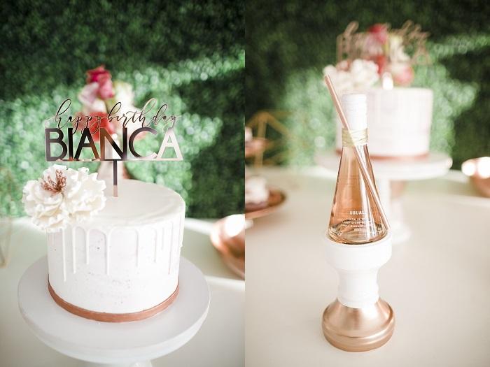 white 40th birthday cake and custom champagne bottle