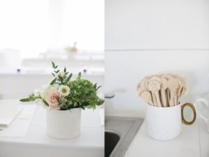 engraved wooden tea spoons in white ceramic canister