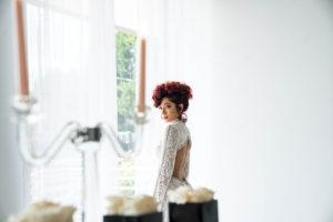model Kayla MaDonna next to window at Park Studios Atlanta
