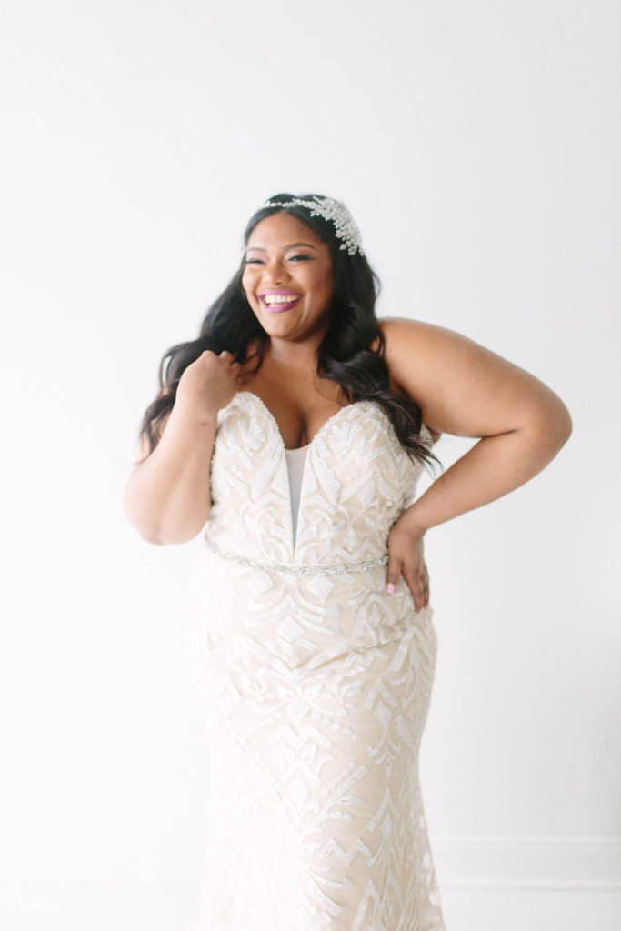 curvy black bride wearing curvy rose wedding gown