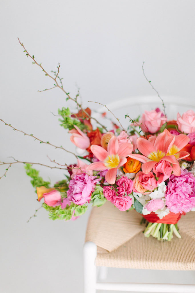 closeup of coral colored wedding floral design by Stylish Stems