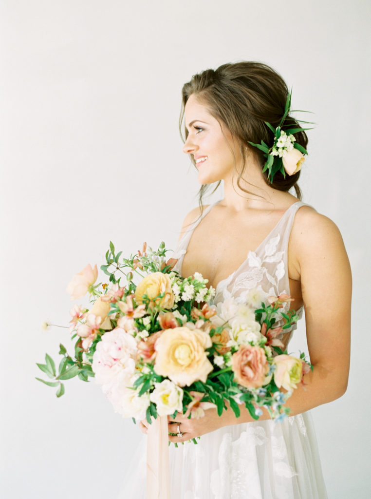 spring wedding bouquet held by bride
