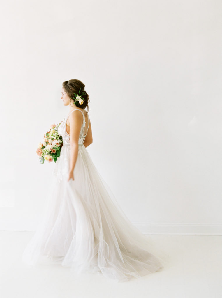 spring bride walking in white space