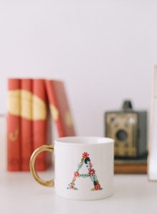 styled floral A mug with gold handle