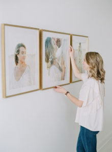 Anna Olivia Photography straightening frame installation