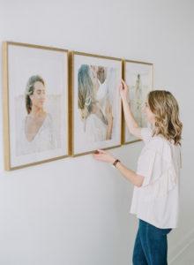 Anna Olivia Photography straightening frame installation