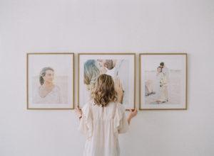 Anna Olivia installing framed wedding prints