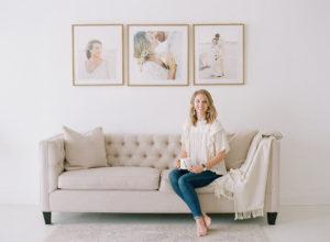 Anna Olivia sitting on beige chaise