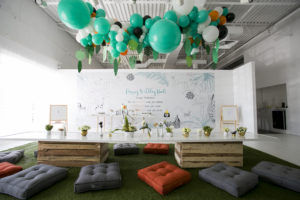 wild one balloon installation over table and seating area