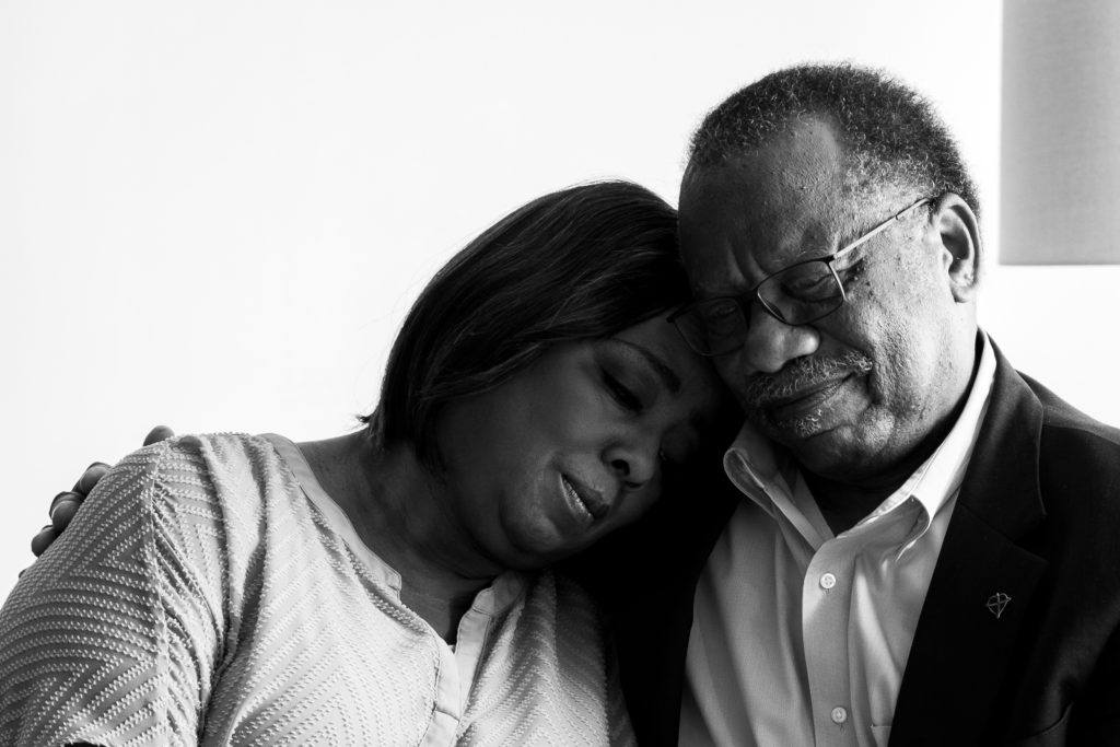 older African American couple embracing, black and white image, Park Studios, Atlanta