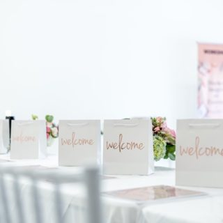 welcome bags, white event space, workshop banner