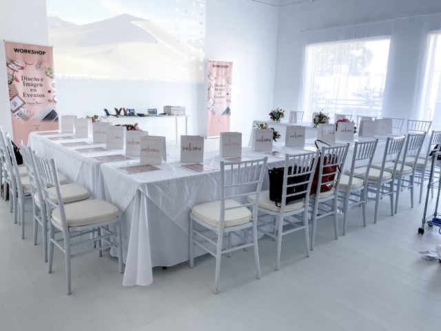 white chairs, white chair cushions, white tablecloths, Atlanta event studio, Atlanta event space, white space Atlanta, white studio Atlanta, Viviana Guerra Event Design Workshop, Viviana Guerra Event Decor Workshop