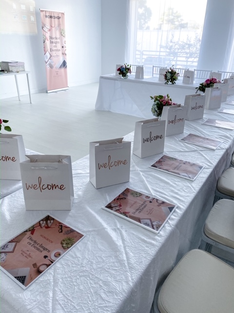 best Atlanta event space, all white studio Atlanta, welcome bags, white tablecloths, event design workshop booklets, workshop banner standup