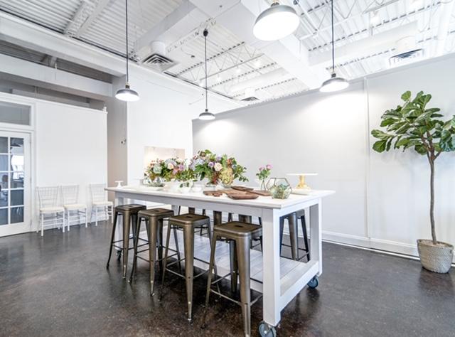 Park Studios Atlanta reception area, fiddle leaf fig, white bar cart, concrete floor