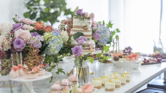 luxury floral arrangements, petit fours, cupcakes, roses, hydrangea, naked cake, cake pops, bud vase
